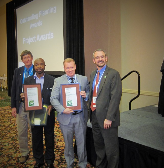 Photos Courtesy of Dylan McKnight.  Dylan McKnight, second from right, and Rickey Hall, third from right, receive an award from the N.C. Chapter of the American Planning Association President John Morck, left, and exiting president Bejamin Hitchings for their work on the Reid Neighborhood Park.