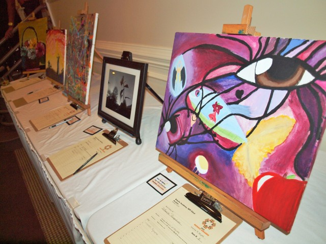 At the Mosaic Awards, there was food, entertainment and a silent auction of Behailu's students' artwork. The painting on the right is titled Different Perspectives.