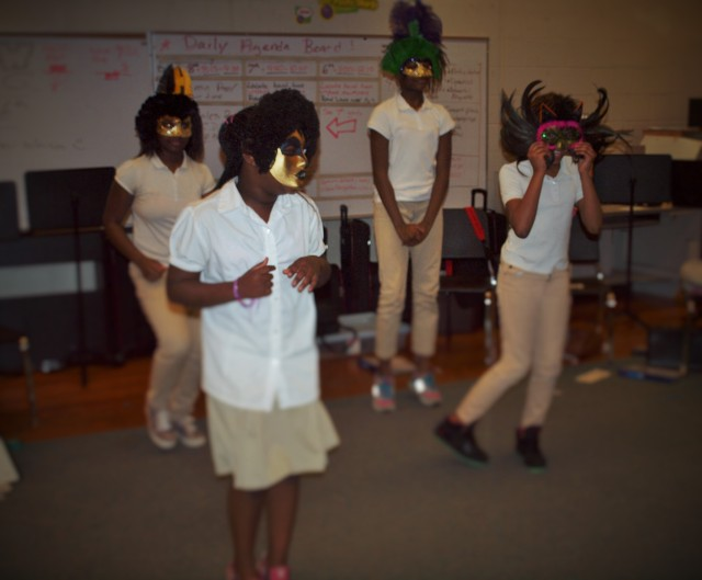 Students perform a dance meant to reveal their true selves through movement during the I-CAP afterschool program.