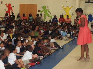 "Sonja Gantt, WCNC news anchor encourages students to find ways to enjoy reading. She said, ""Whatever you are interested in, you can always find a book about it."""