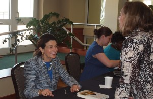 "Former U.S. Senator Olympia Snowe autographs her book, ""Fighting for Common Ground: How We Can Fix the Stalemate in Congress"" and talks to fans in the ballroom lobby."
