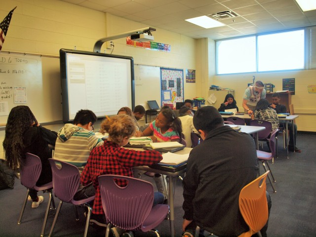 Seventh-graders work in small groups to learn math in a Teach to One classroom at McClintock Middle School.