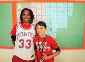 Math Director Dawn Salters stand with one her students, Joel Holder.
